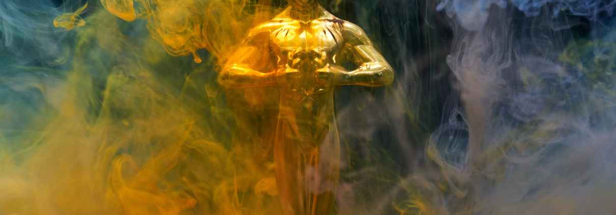 gold coloured human statue