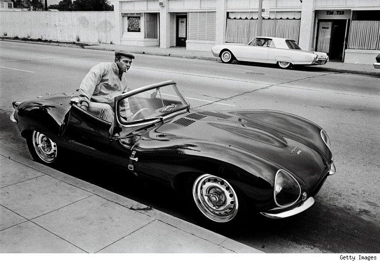 Steve McQueen hopping in his Jaguar XKSS-- 1963.