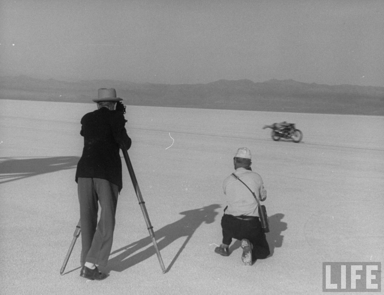 Roland Free breaking world's speed record on Bonneville Salt Flats while photographers try to snap pictures  --September, 1948.