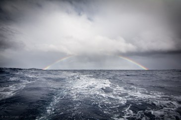 rainbow from a squall sailing, sv cavalo