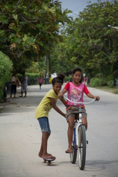 girls on bicycle and skateboard majuro marshall islands, sv cavalo