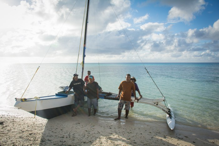 marshallese men with sailing canoe, ailuk atoll, marshall islands