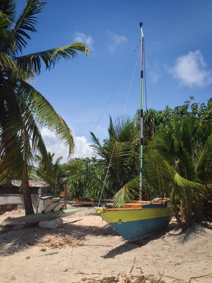 sailing canoe put away on the beach, ailuk atoll, marshall islands