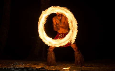man spinning fire in fiji