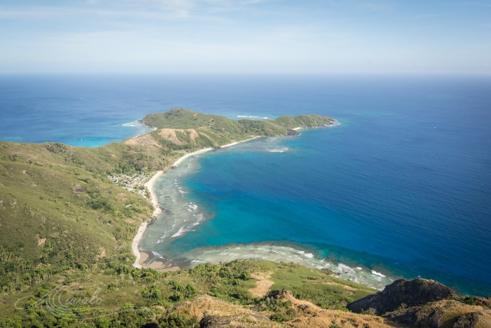 view of village and reef of waya island fiji yasawa
