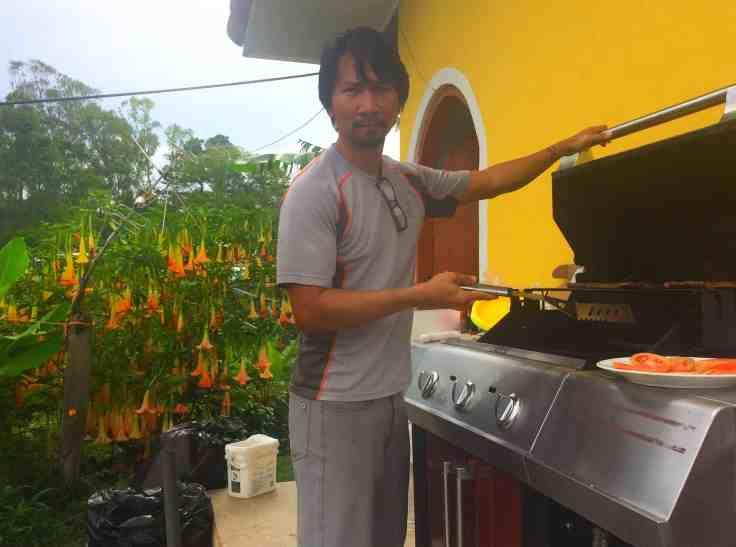Trin flipping burgers at the Cabalgata
