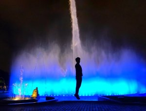 Trin in front of Magic Fountain for Christmas in Peru