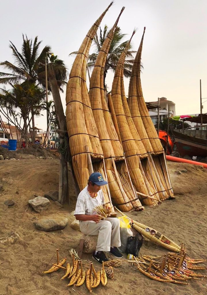A local craftsman making small Reed boats used by the indigenous people in Peru