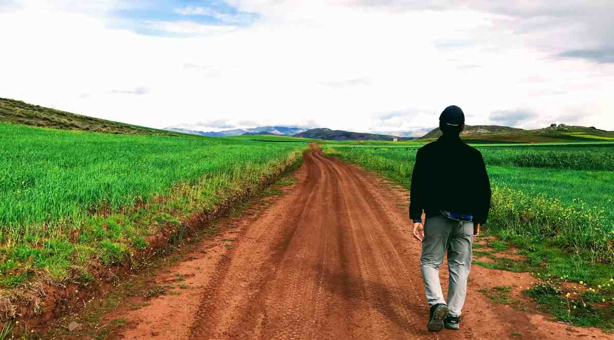 Walking on a road in the sacred valley, Peru reinventing your life