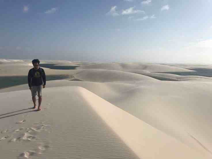 At the top of a sand dune in Lençóis Maranhenses National Park the Most beautiful place in the world