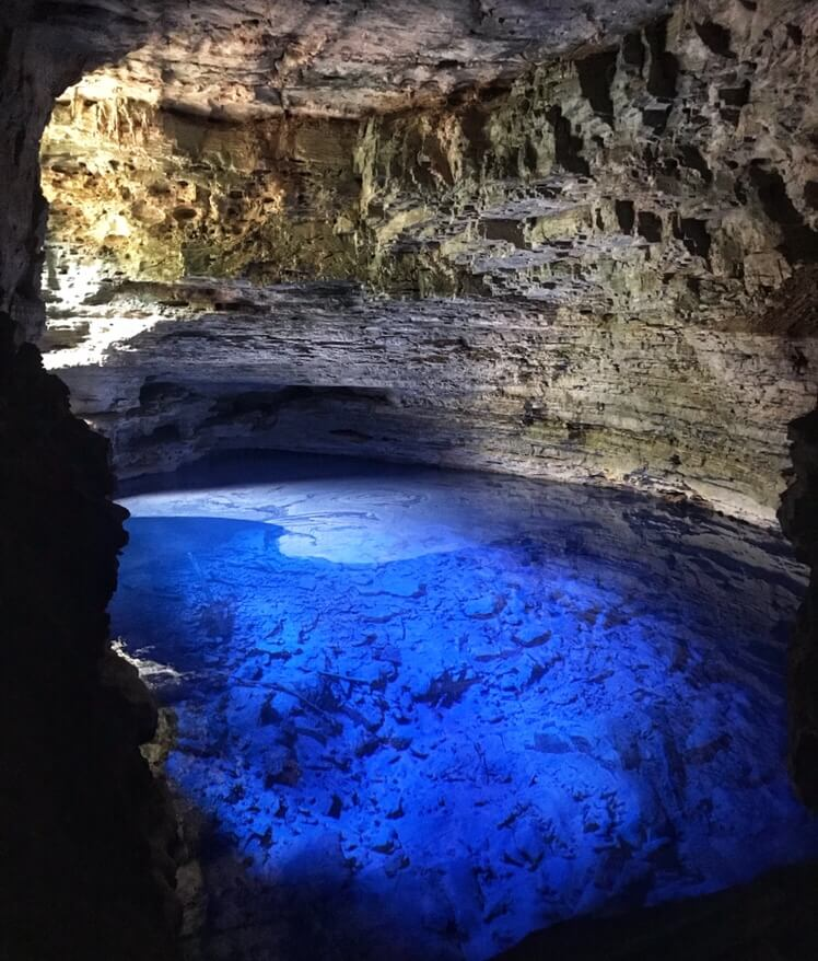 The enchanted well glowing in a cave