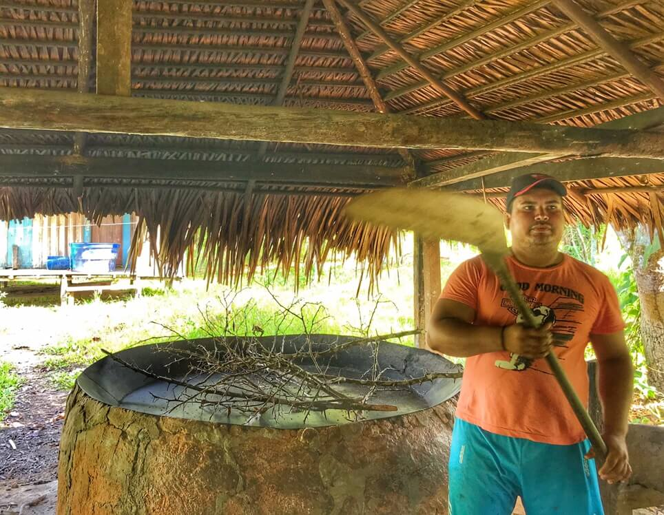 Caca demonstrating how to make Manioc in the Amazon Jungle