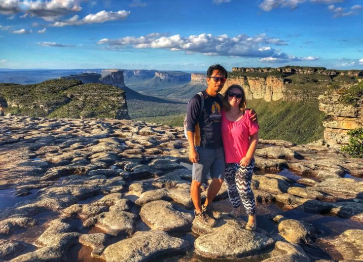 Trin and Bonnie standing on a heart shapped rock on a a plateau in Chapada Diamantina one of the places to visit in Brazil