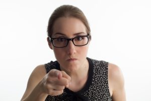 Angry person pointing a finger