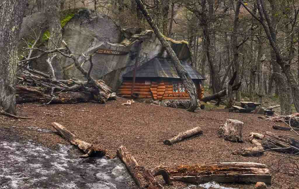 Shelter using a natural rock formation for two sides and the roof near Bariloche Argentina