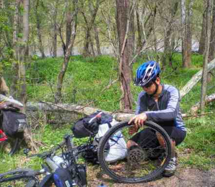 Trouble doesn't have to be a disaster. Trin fixing a tire on the C&O trail, Maryland