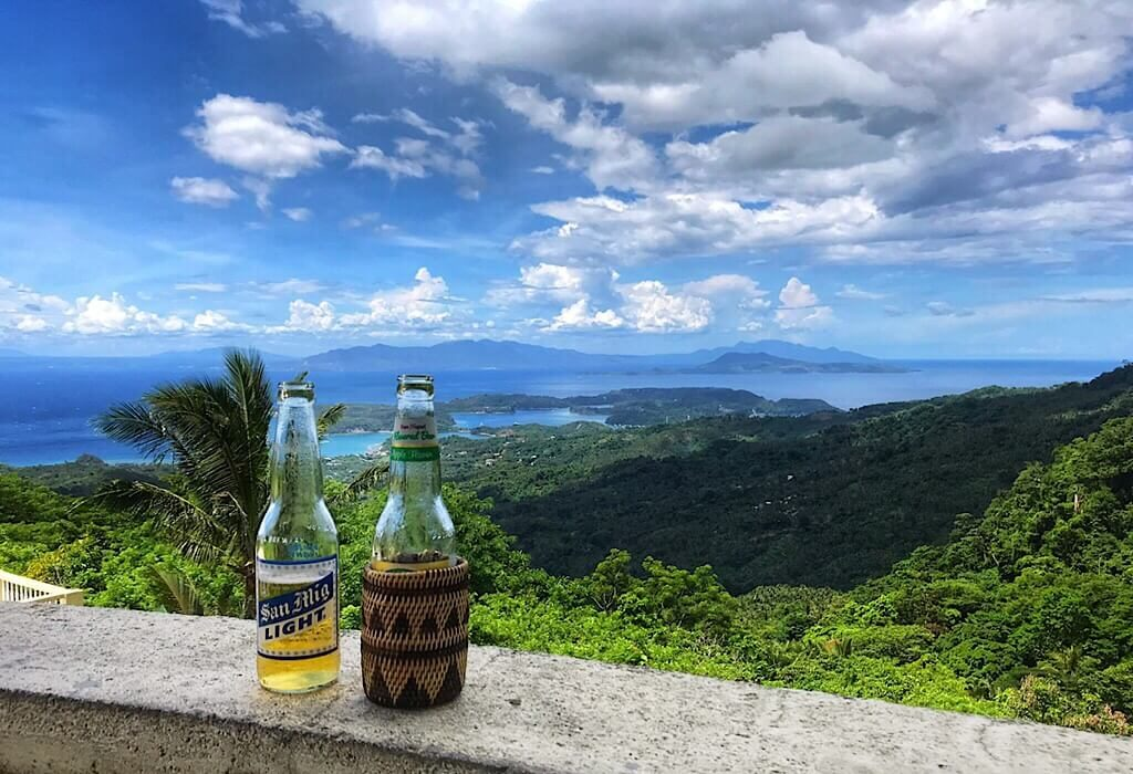 Two beers on a ledge overlooking the bay of Puerto Galera