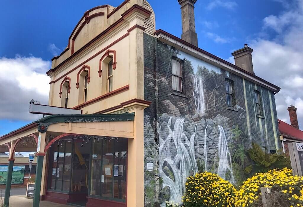 A scenic nature mural on the side of a store in Sheffield Tasmania, Australia