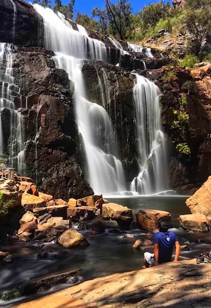 Trin cooling off his feet at the base of Mackenzie Falls in the Grampians
