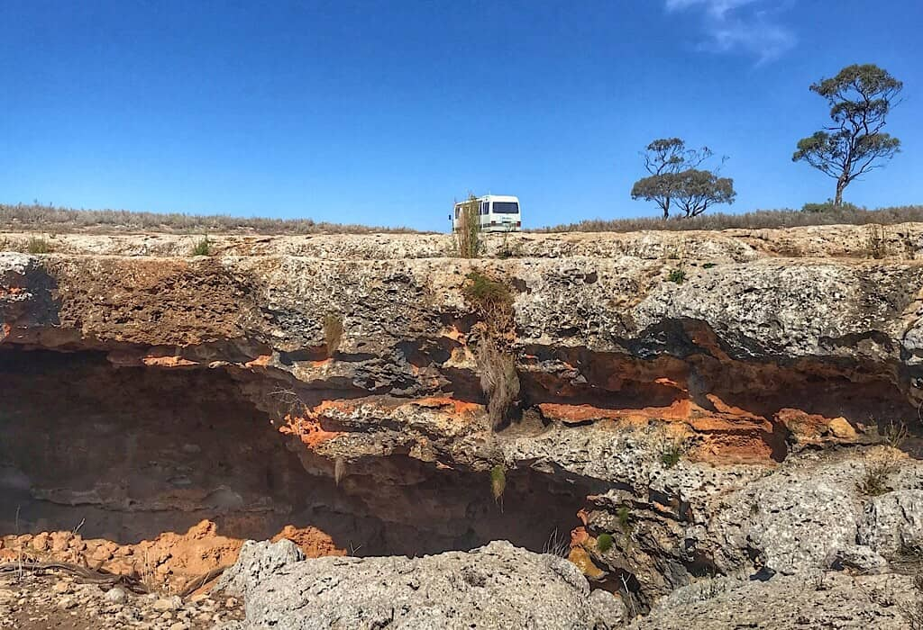 Sinkhole on the Nullarbor with a dingo den and a cave with bats