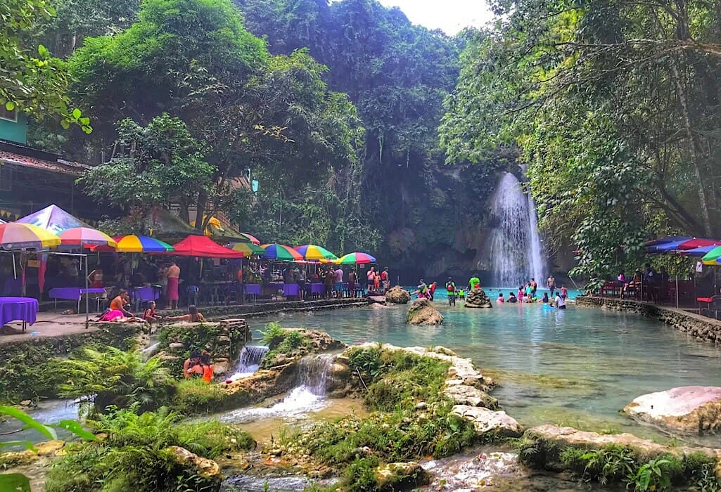 Crowds along the fabled blue river in Siquijor, Philippines