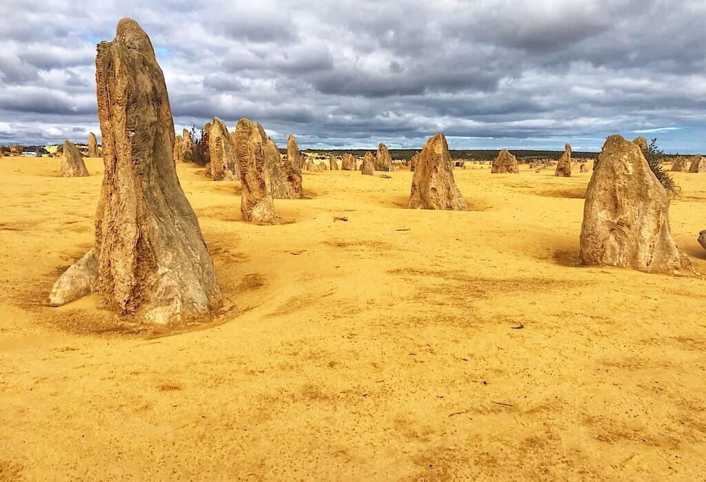 Multiple sandstone Pinnacles standing erect in the desert