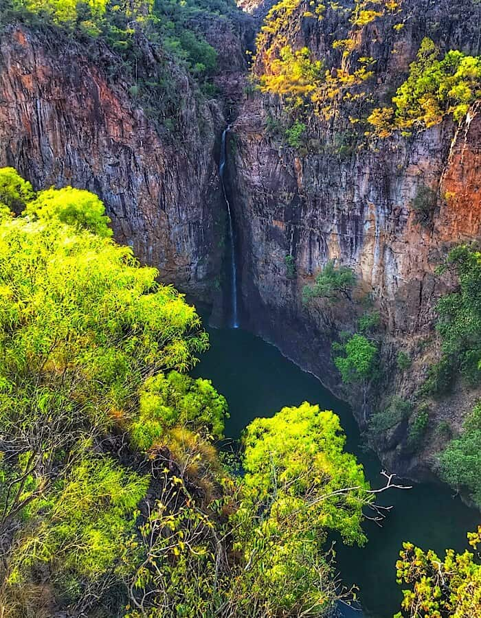 Tolmer Falls, a long drop waterfall into a plunge pool surrounded by cliffs