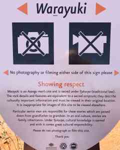 Sign post for the sacred area for men specifying that pictures are not allowed.