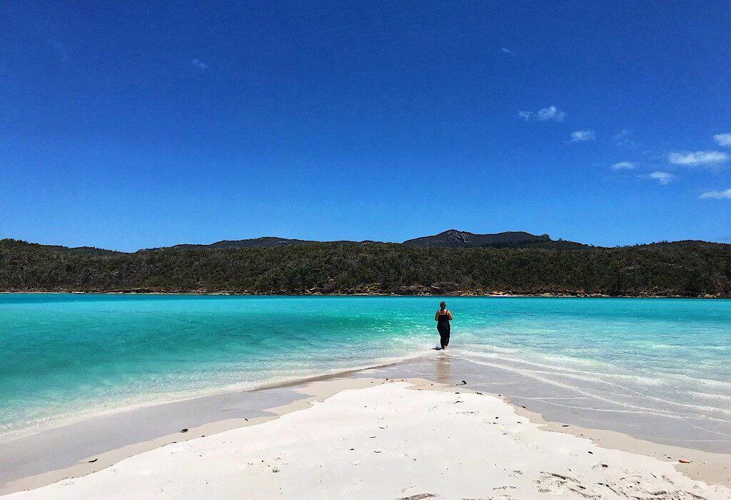 Whitehaven beach surrounded by the blue water of the Hill Inlet.