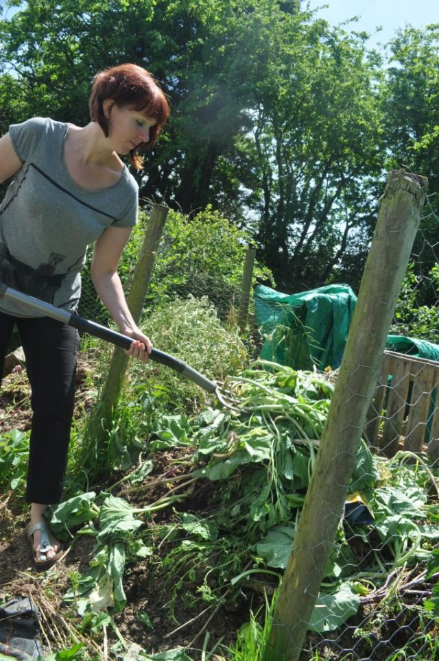 Kim turning her compost heap