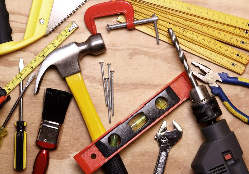 assorted work tools on wood   learn basic carpentry skills