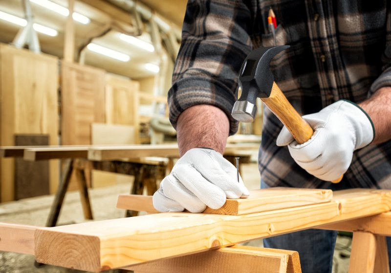 close carpenter his hands protected by   how to learn basic carpentry skills