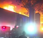 Incredible Video of Mother of Three Rescued By Firefighters in A Raging Fire