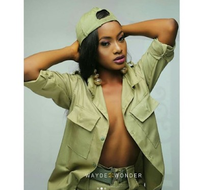Lady Who Flashed Nipples in NYSC Crested Vest, Is Back Again With More Sexy Photos in NYSC Khaki