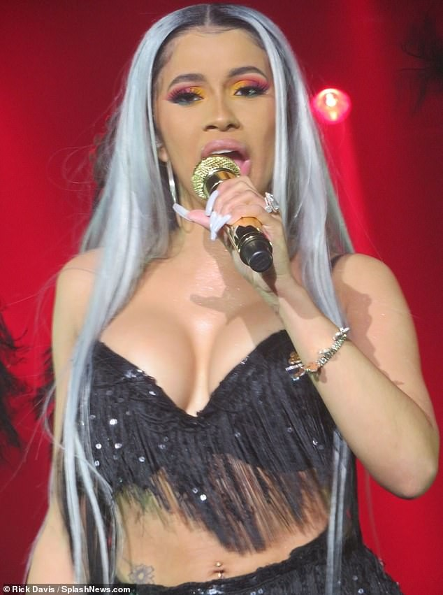 Cardi B flashes massive cleavage and backside in fringed bralet and skirt as she performs in New York City (Photos)