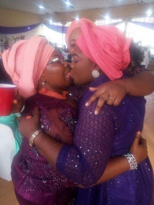 Photo of The Day: Two Nigerian Women Publicly Locking Lips At A Wedding