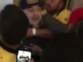 Football legend Diego Maradona throws a punch at a reporter after his team lost?the Ascenso MX play-off final (Video)