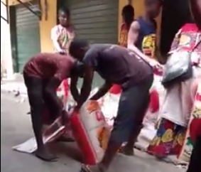Rice sellers caught on camera removing portions of rice from bags and repackaging to sell as a full bag (video)