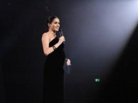Meghan Markle presents an award to designer of wedding dress,?Clare Waight Keller at the British Fashion Awards
