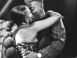 """Your love is overwhelming"" - Simi tells Adekunle Gold after they share a kiss on stage (photos)"