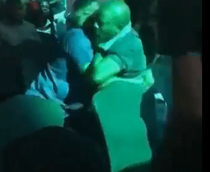 Trending video of a husband fighting another man for taking his wife to BurnaBoy