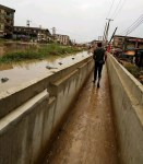 Aba Residents Passes Through Dry Gutter Following Heavy Rain That Flooded Roads But Left The Drainage Dry