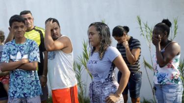 """People wait for information in front of the training center of Rio""""s soccer club Flamengo, after a deadly fire in Rio de Janeiro, Brazil February 8, 2019"""
