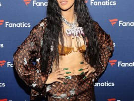 Cardi B flaunts her boobs in skimpy gold bra and shorts at Fanatics Super Bowl party in Atlanta (Photos)