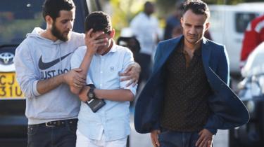 Grieving relatives leave an information centre following the Ethiopian Airlines plane crash, at Jomo Kenyatta International Airport, Nairobi, Kenya, March 10, 2019