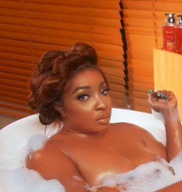 Anita Joseph soaks naked in a bathtub