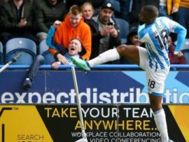 Huddersfield's Isaac Mbenza breaks the corner flag after scoring against Manchester United