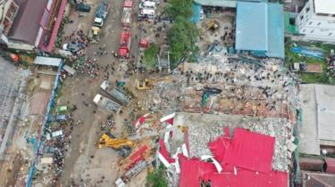 An overhead view of the collapsed under-construction building