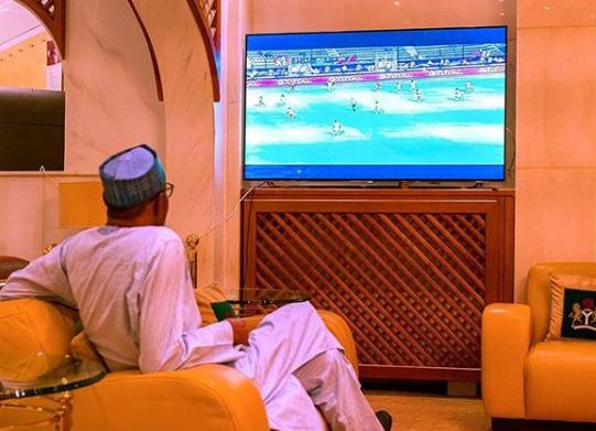 Photo of President Buhari watching the Nigeria vs Burundi match