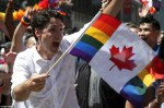 Canada Prime Minister Justin Trudeau Proudly Flies The LGBTQ2 Flag At Toronto Pride Parade [Photos]
